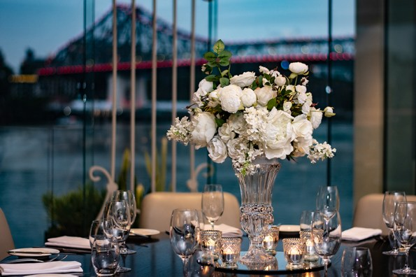 blackbird-wedding-reception-styling-clear-crystal-cut-tall-footed-vase-faux-silk-flower-floral-arrangement-bouquet-guest-table-centrepiece-vintage-tealights-brisbane-storey-bridge-view