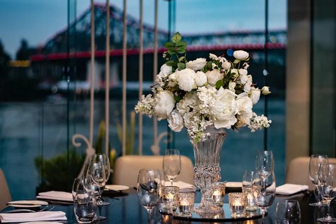 blackbird-wedding-reception-styling-clear-crystal-cut-tall-footed-vase-faux-silk-flower-floral-arrangement-bouquet-guest-table-centrepiece-vintage-tealights-brisbane-storey-bridge-view