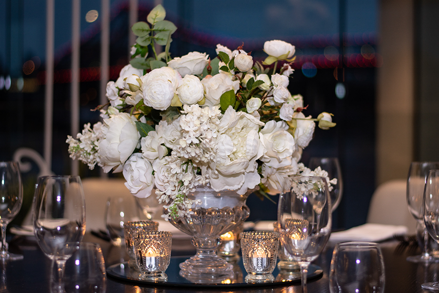 blackbird-wedding-reception-styling-clear-crystal-cut-footed-bowl-vase-faux-silk-flower-floral-arrangement-bouquet-guest-table-centrepiece-vintage-tealights-brisbane-storey-bridge-view