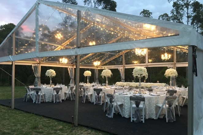 walkabout-creek-marquee-wedding-reception-silver-pedestals-ivory-floral-toppers-chandeliers