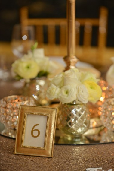 samantha-&-callum-easts-leagues-club-wedding-reception-styling-guest-table-centrepiece-gold-candelabra-gold-textured-vase-fresh-flowers-florals-diamante-tealight-votives-table-number