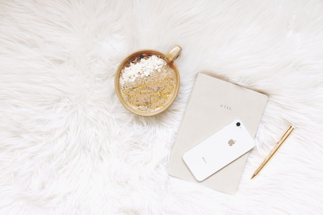 Diary and Phone on white rug