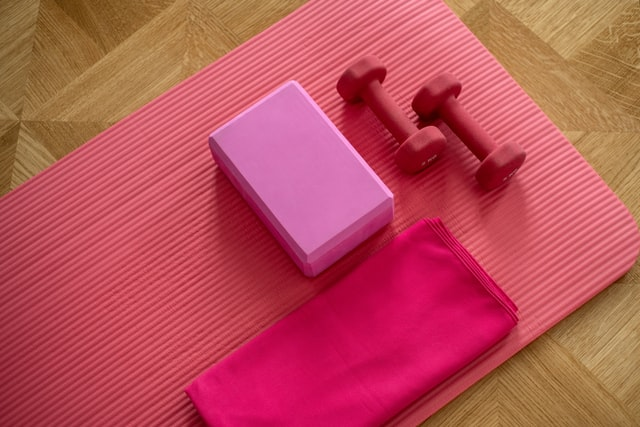 Pink exercise mat and weights