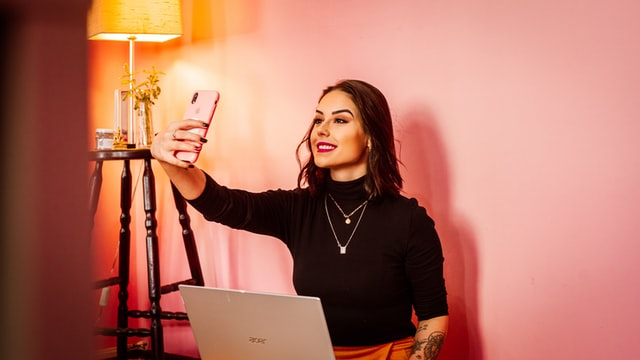 Woman taking selfie with mobile phone