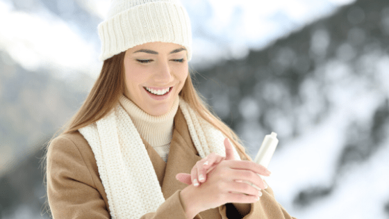 Woman wearing hat and gloves in the snow