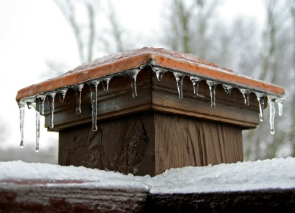 railing post with ice