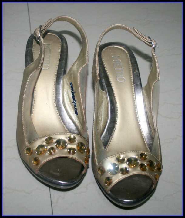 Golden sandals from Metro