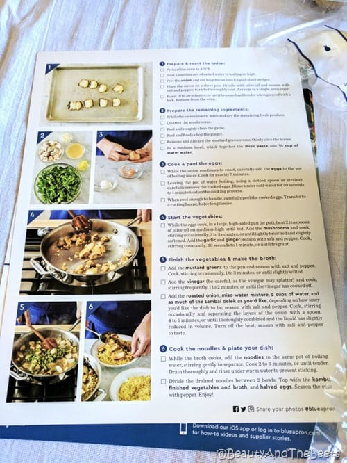 a recipe card with step by step instructions on a white tablecloth