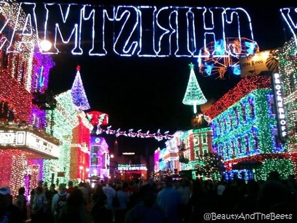 colorful Christmas lights on buildings on street