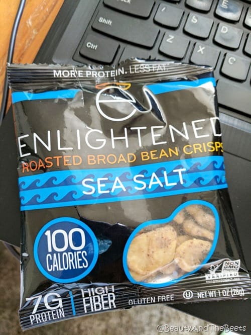 A black and blue colored bag of Enlightened Bean crisps on a laptop keyboard for Friday Favorites