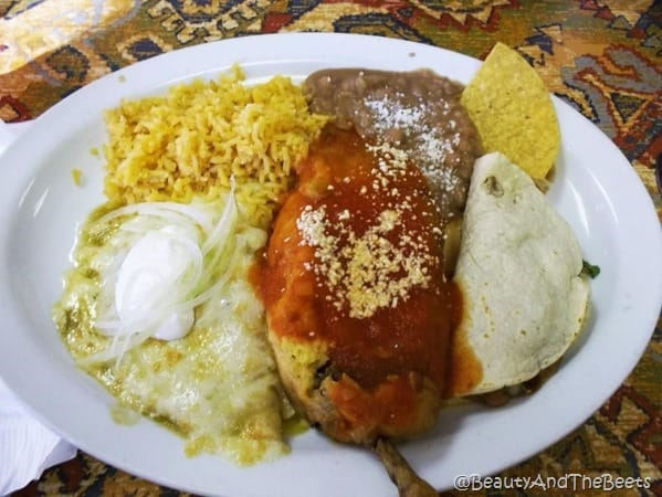 a white plate of chili relleno cheese sour cream and tortillas