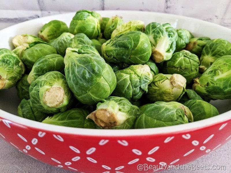 Brussels sprouts in red bowl Beauty and the Beets