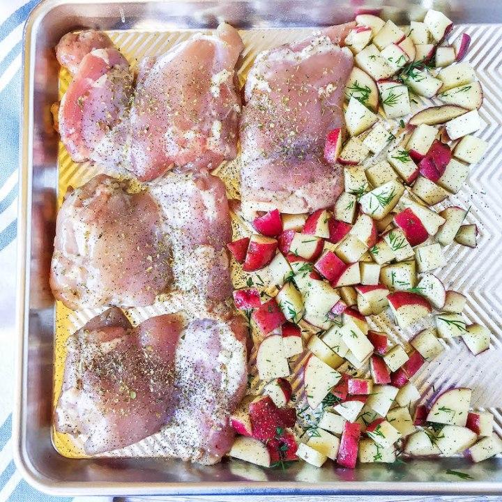 chicken thighs, potatoes on a sheet pan