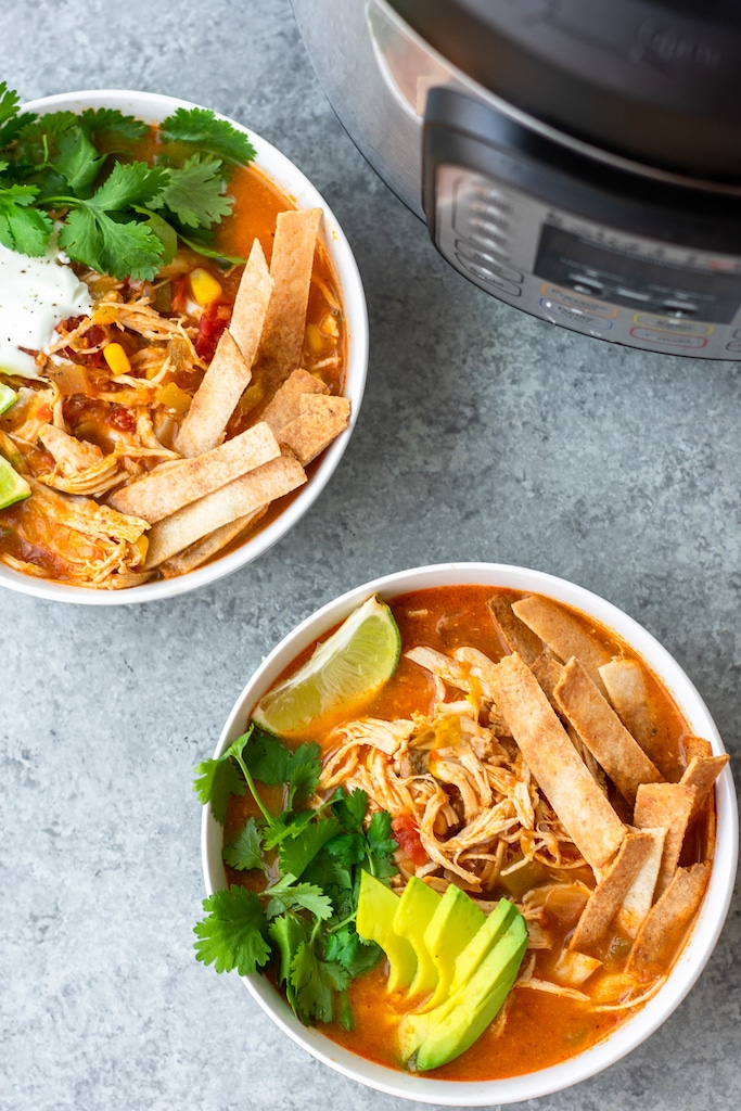 paleo chicken tortilla soup in two bowls with the instant pot