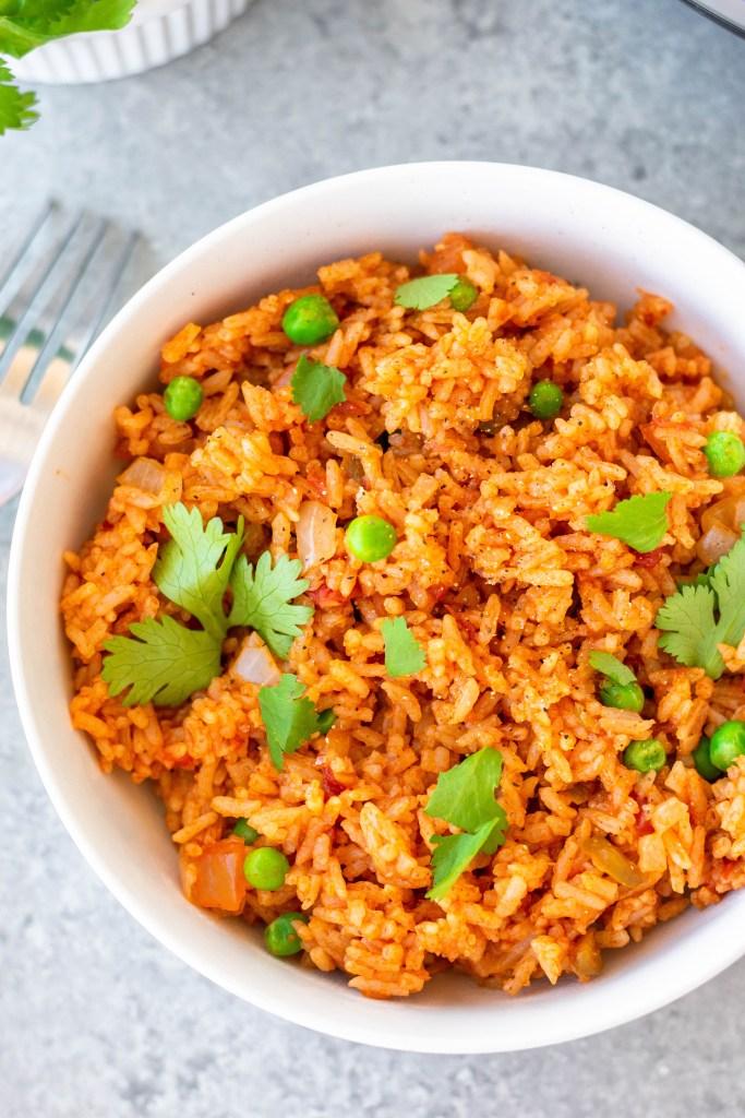 prepared Spanish rice in a bowl with cilantro garnish
