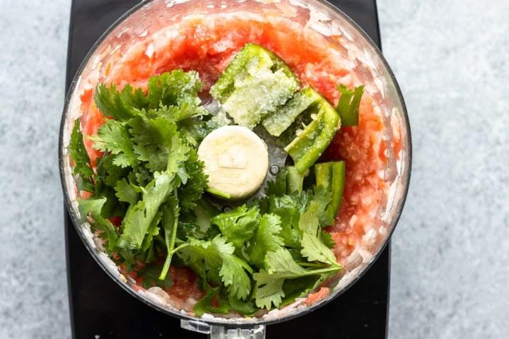 cilantro, jalapeno, lime and salt added to food processor