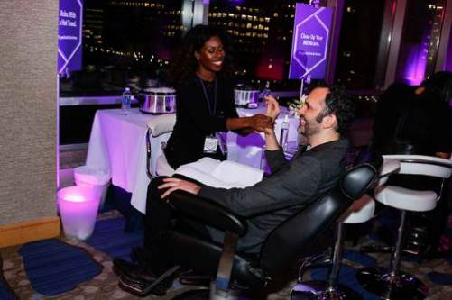 "James Beard Award-winning pastry chef and Cronut® creator Dominique Ansel gets a menicure at the on-the-go beauty bar, created by fashion designer Cynthia Rowley and tech mogul and businesswoman Randi Zuckerberg, at the Hyatt Regency ""It's Good Not To Be Home"" event. Photo Credit: Mansueto Ventures"