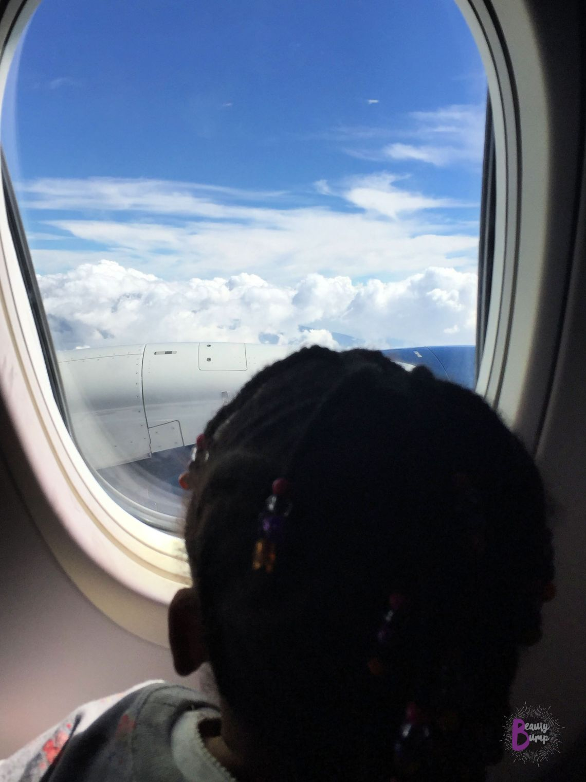 TRaveling with kids Get the kid a window seat so that they are able to see the take-off and landing, as well as the clouds.
