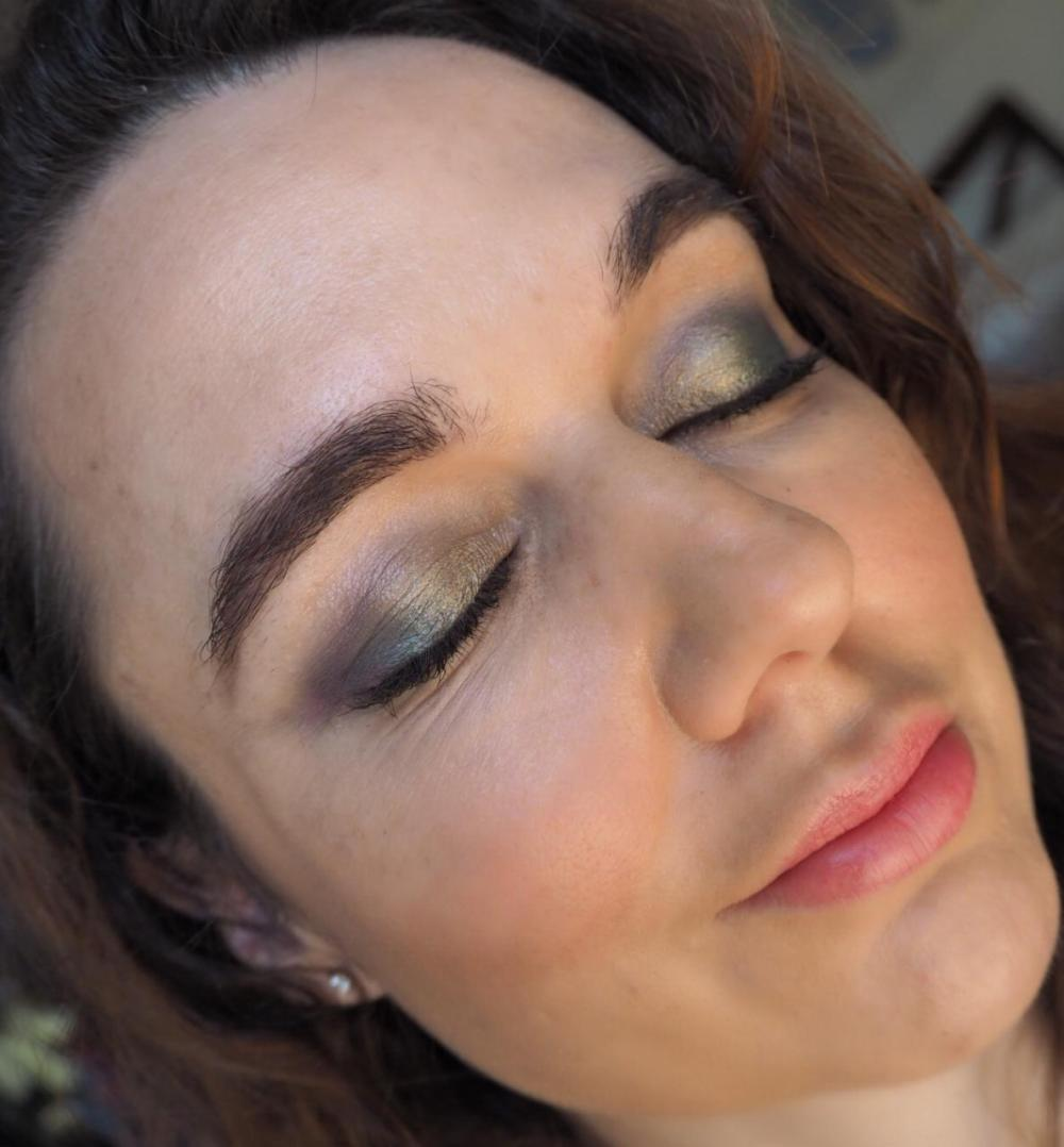 Freedom House of Glam Dolls Exotica Dolls- made up face with eyes closed showing metallic green eyeshadow