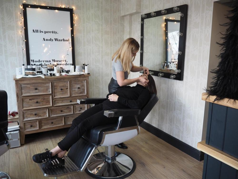 High Definition HD Brow Treatment Cardiff Salon Nia. Shot of lady leaning over other lady doing her brows