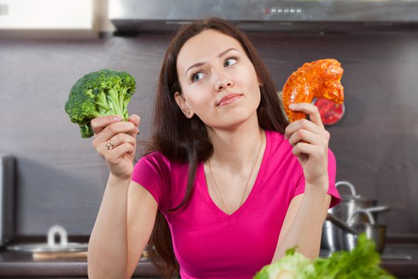 woman-wondering-whether-to-eat-meat-or-vegetables