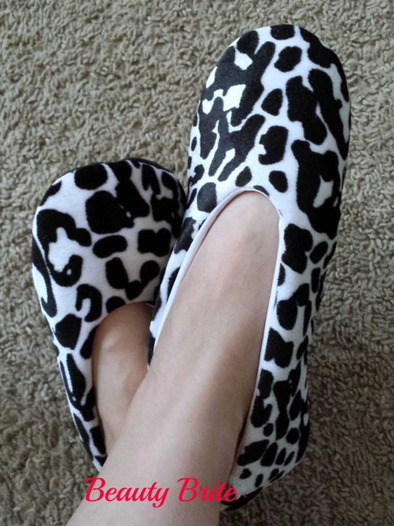 Wearing Cuddle Cow Moisture Replenishing Slippers