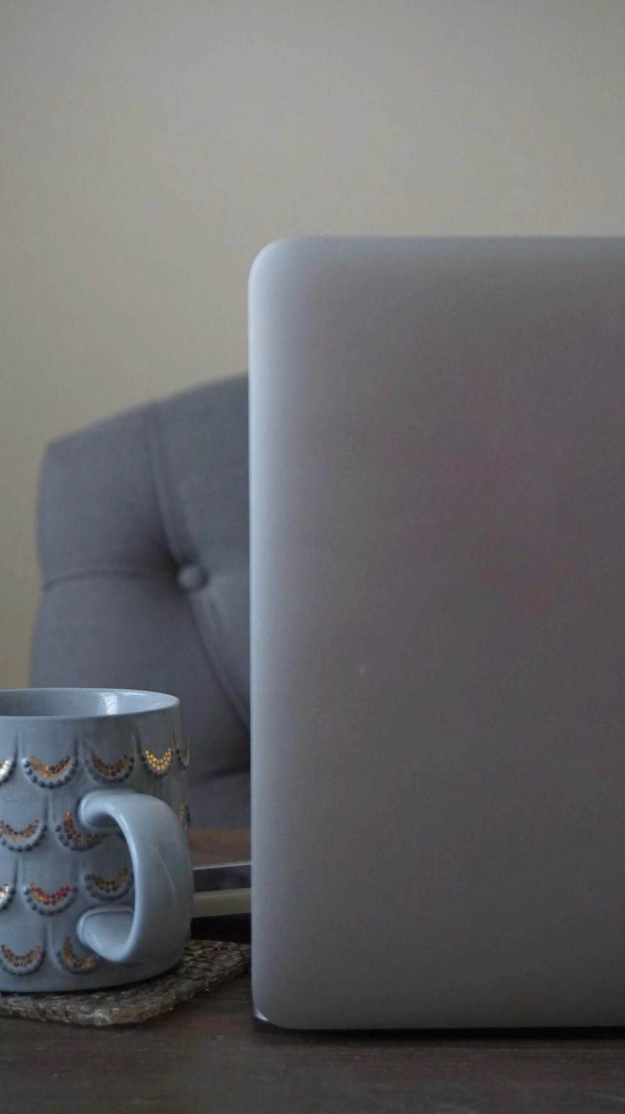 Computer and Coffee Cup Up Close