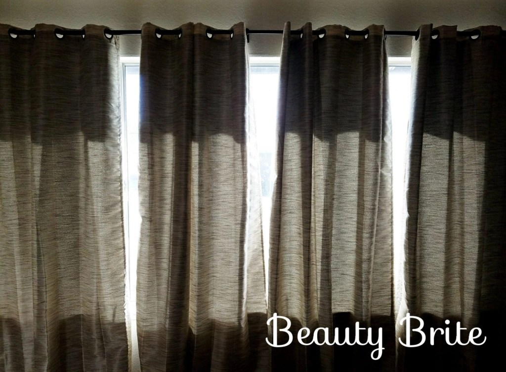 Eclipse Thermalayer Deron Blackout Grommet Curtain Panels hanging up