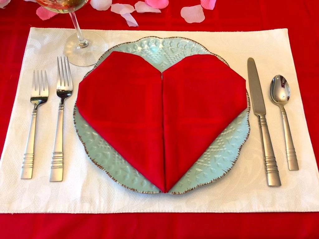Place setting with heart shaped linen napkin
