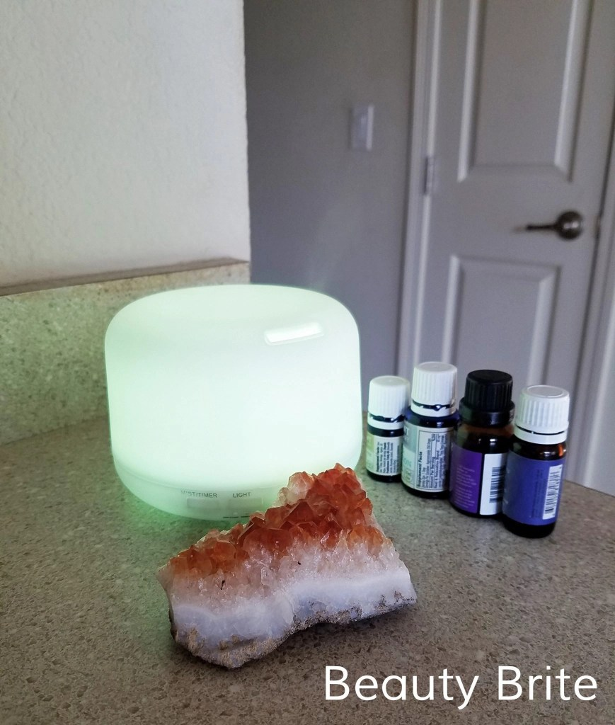 Oil diffuser in green with essential oils