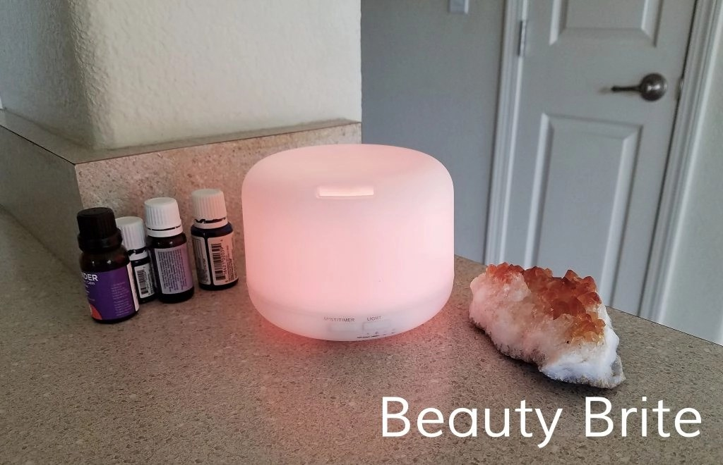 Oil diffuser in red with essential oils and citrine