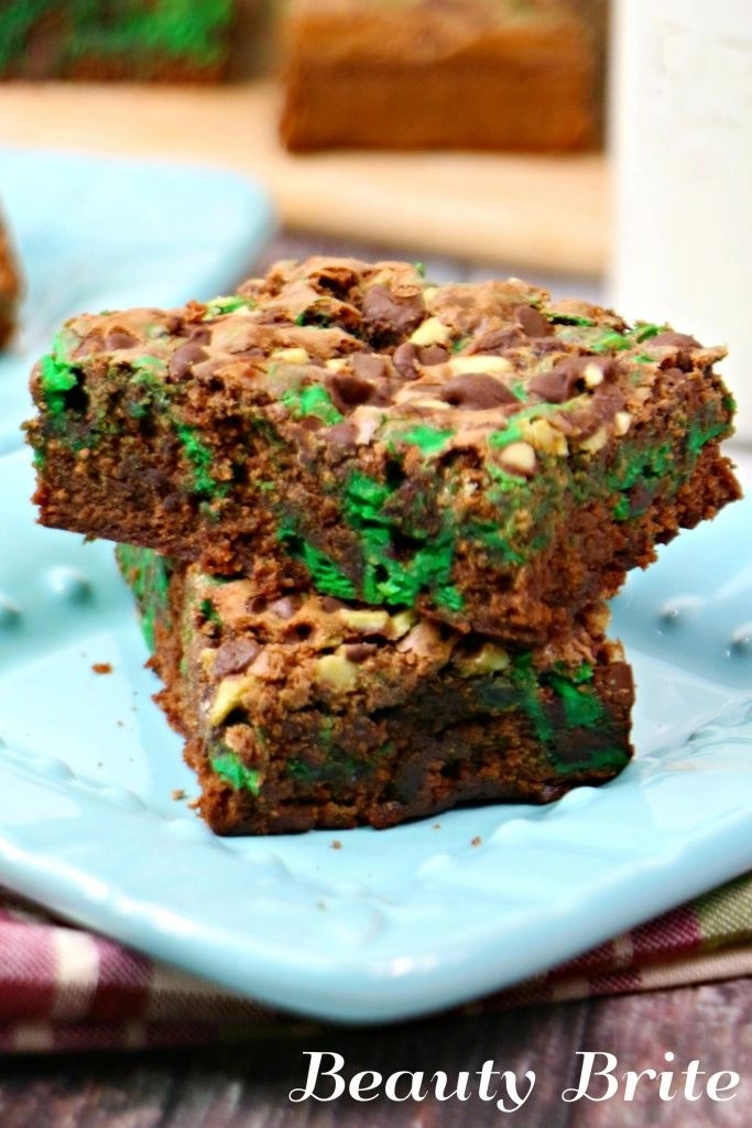 Mint Chocolate Swirl Brownies on blue plate, ready to serve