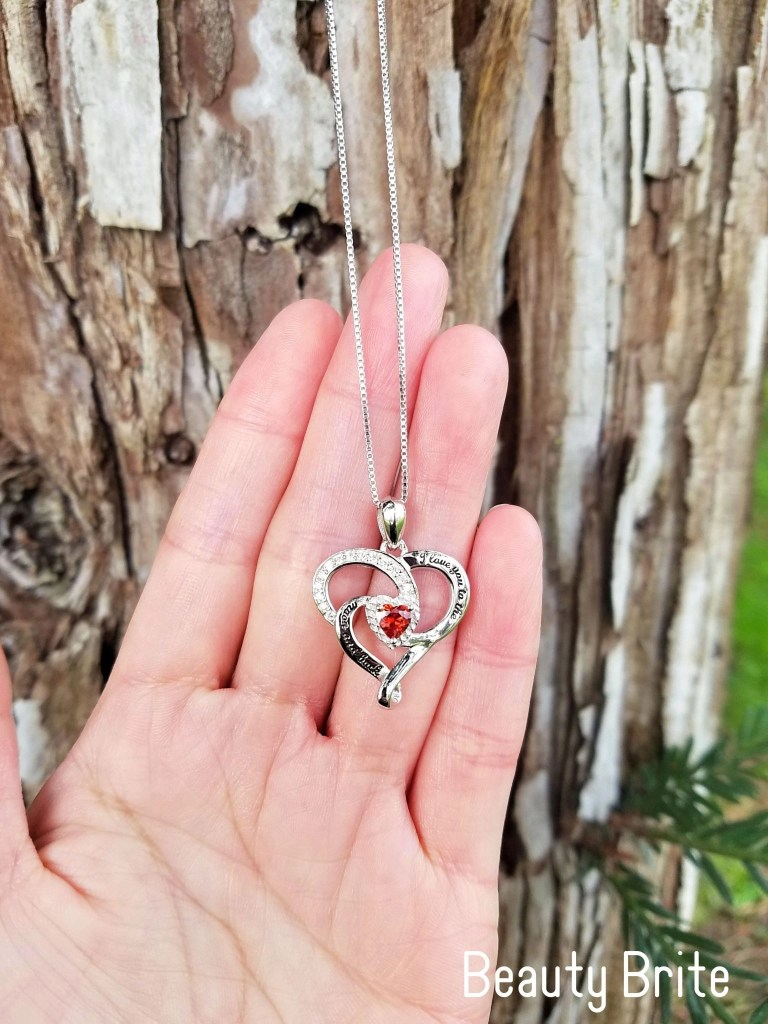 I Love You To The Moon And Back Birthstone Necklace Garnet in hand