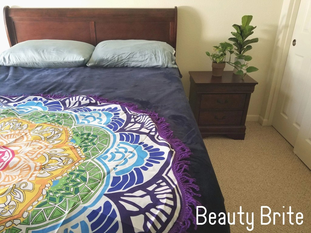 Lotus Yoga Mat displayed on bed