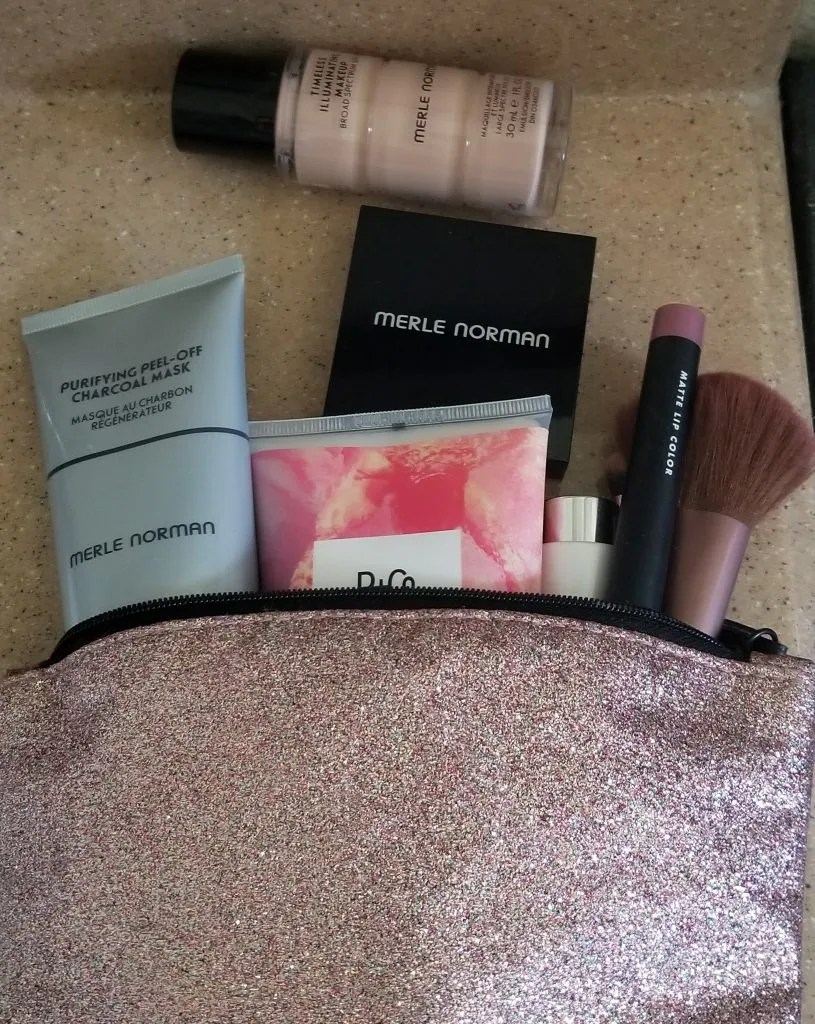 Merle Norman Purifying Peel-off Charcoal Mask, Timeless Illuminating Makeup Broad Spectrum 30, and Ultra Glow Powder Highlighter
