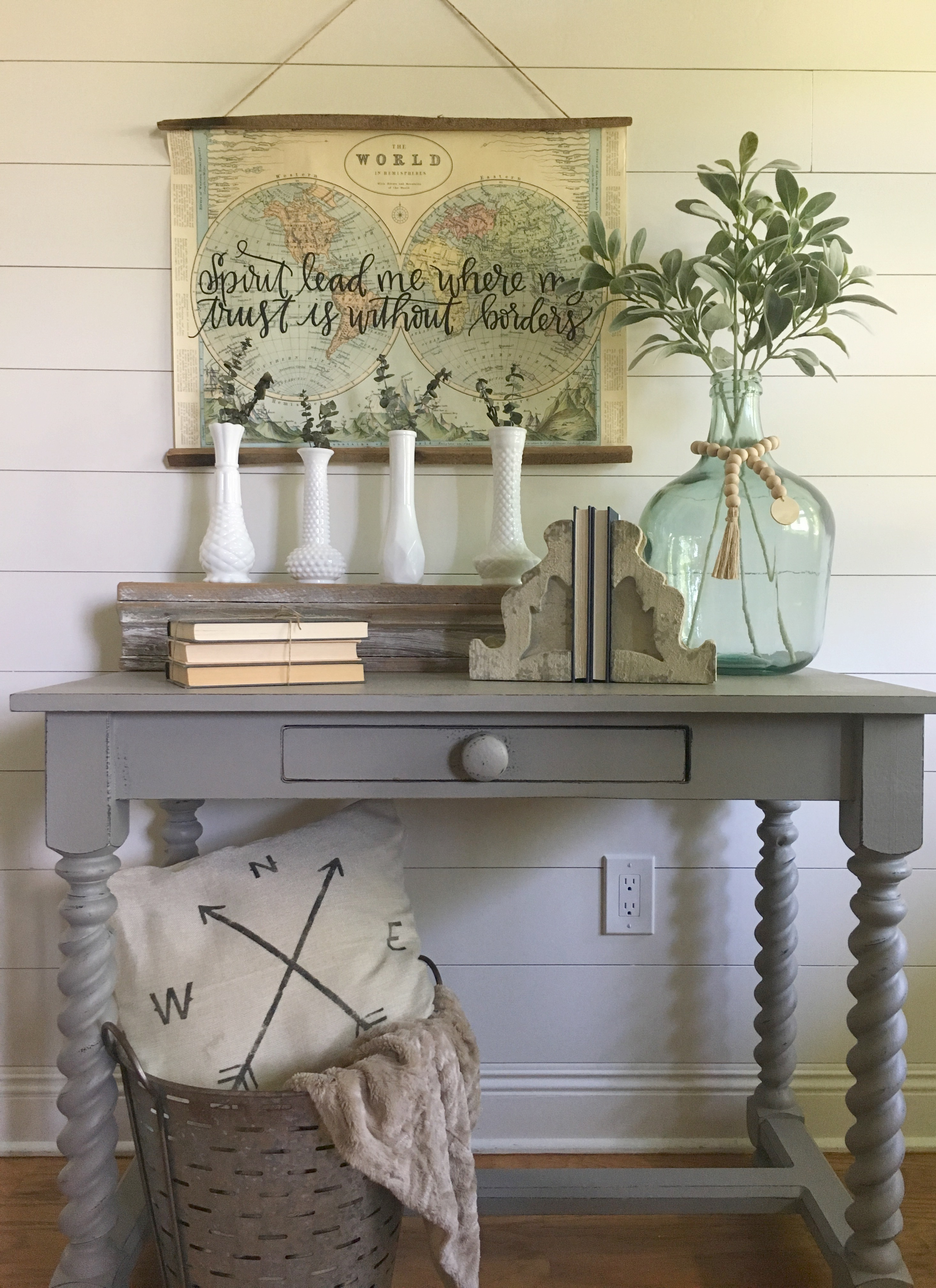 A step-by-step DIY for chalk painting and distressing a table; along with pictures on how to style it with modern farmhouse decor.