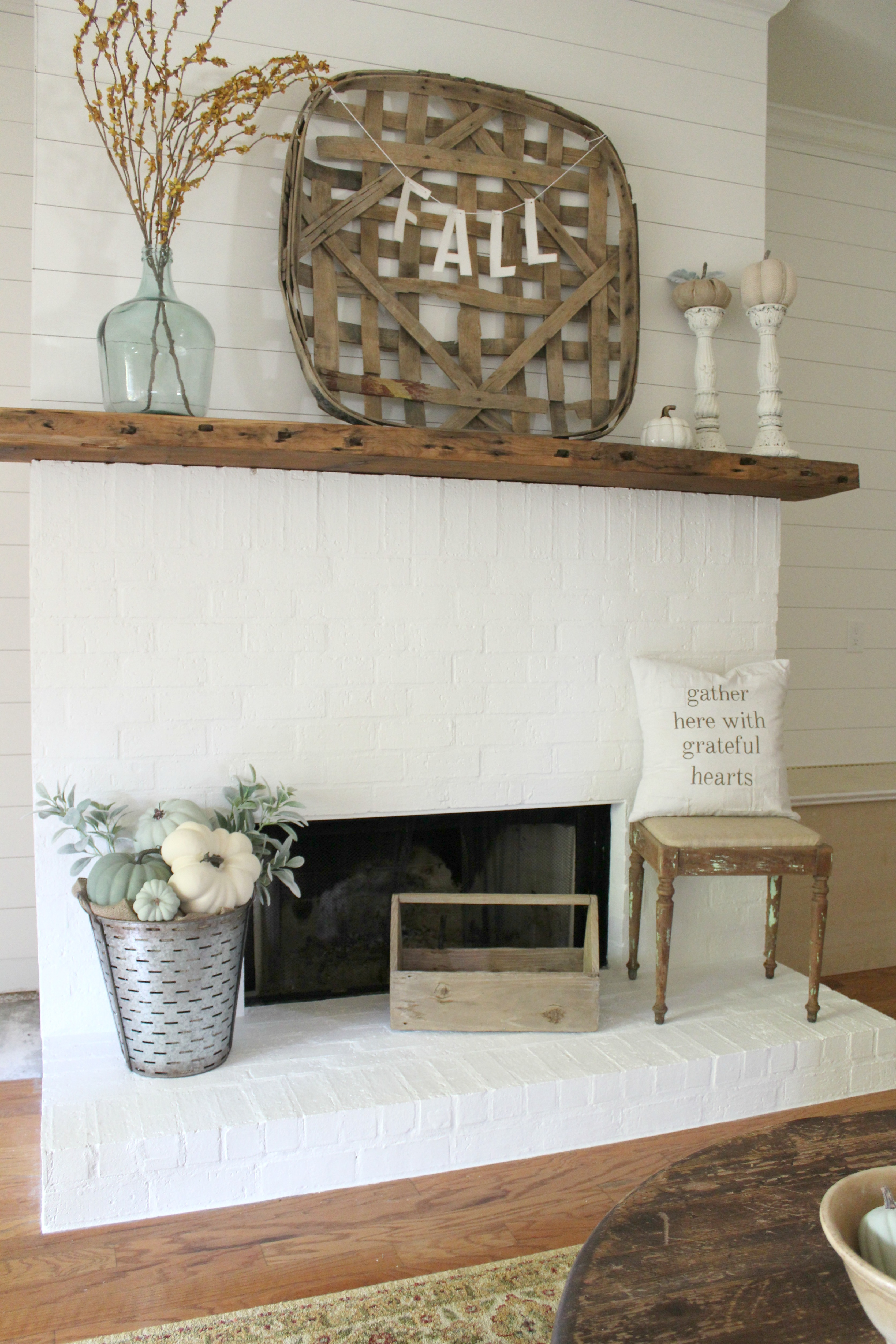 Learn how to create a farmhouse living room on a tight budget. A DIY renovation with lots of vintage charm and character.