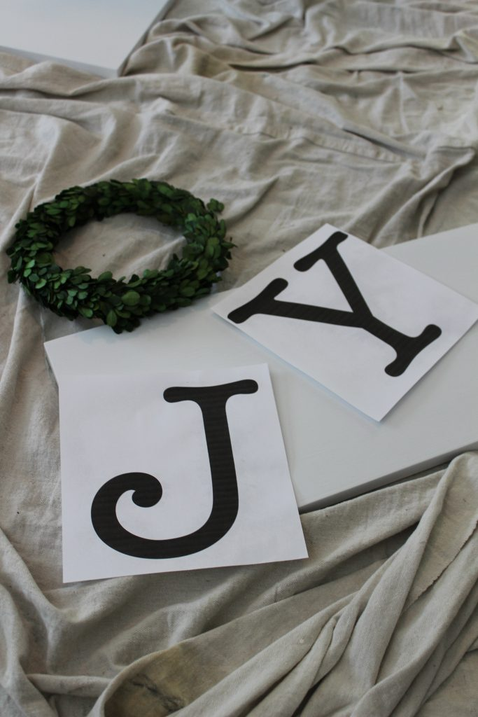 How to make a JOY farmhouse Christmas sign. An easy and inexpensive DIY to add farmhouse charm to your home for Christmas.