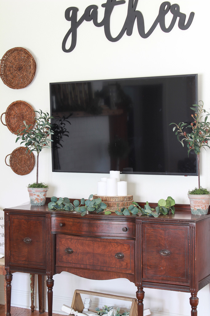 Make an olive tree topiary in less than 5 minutes and for less than 10 dollars. Topiaries are beautiful decor, but they can be expensive. Learn how to make a budget friendly topiary that is just as beautiful as one that is store bought.