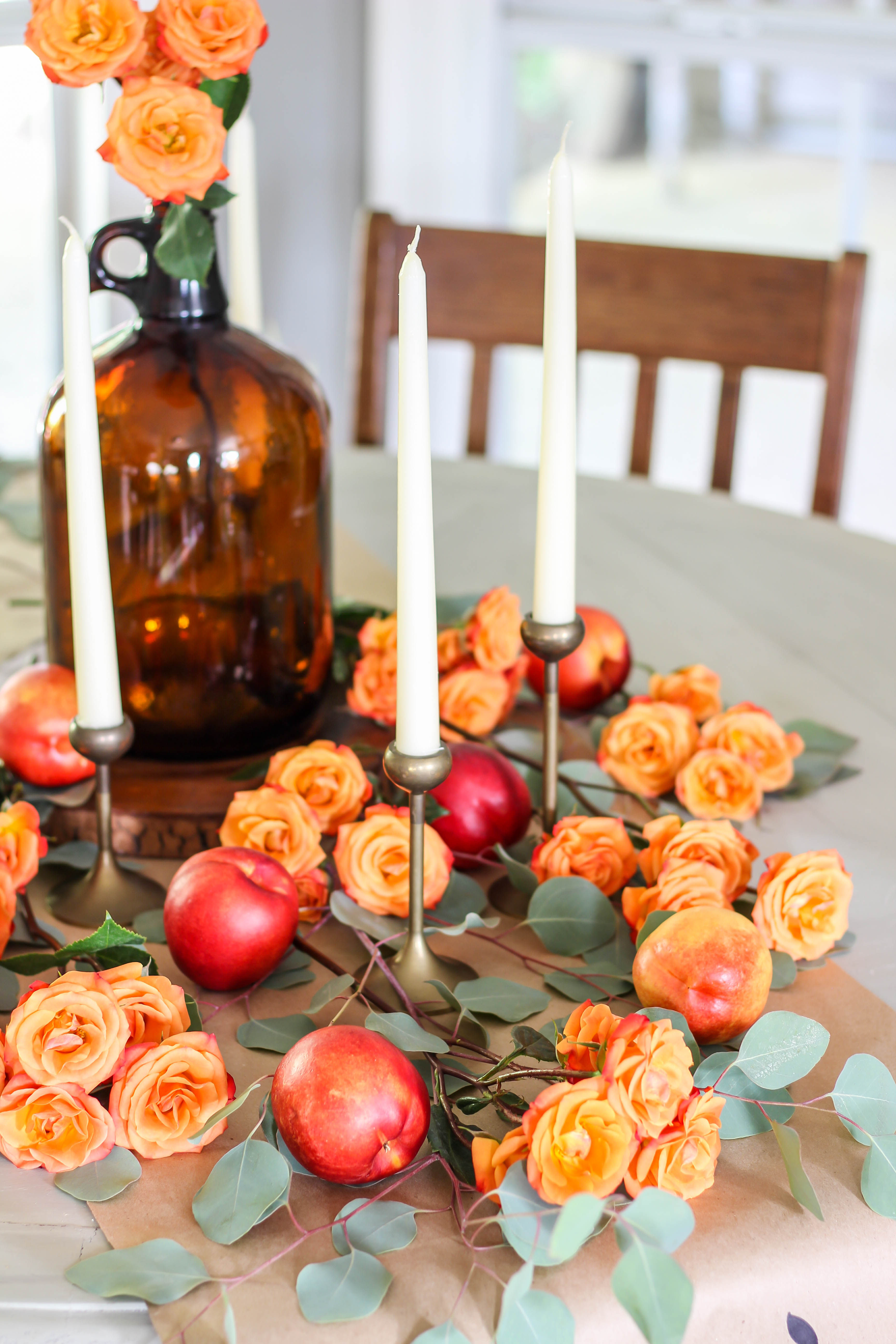 How I created a fall tablescape using fresh fruit and florals. This tablescape has so much color and texture that is perfect for fall.