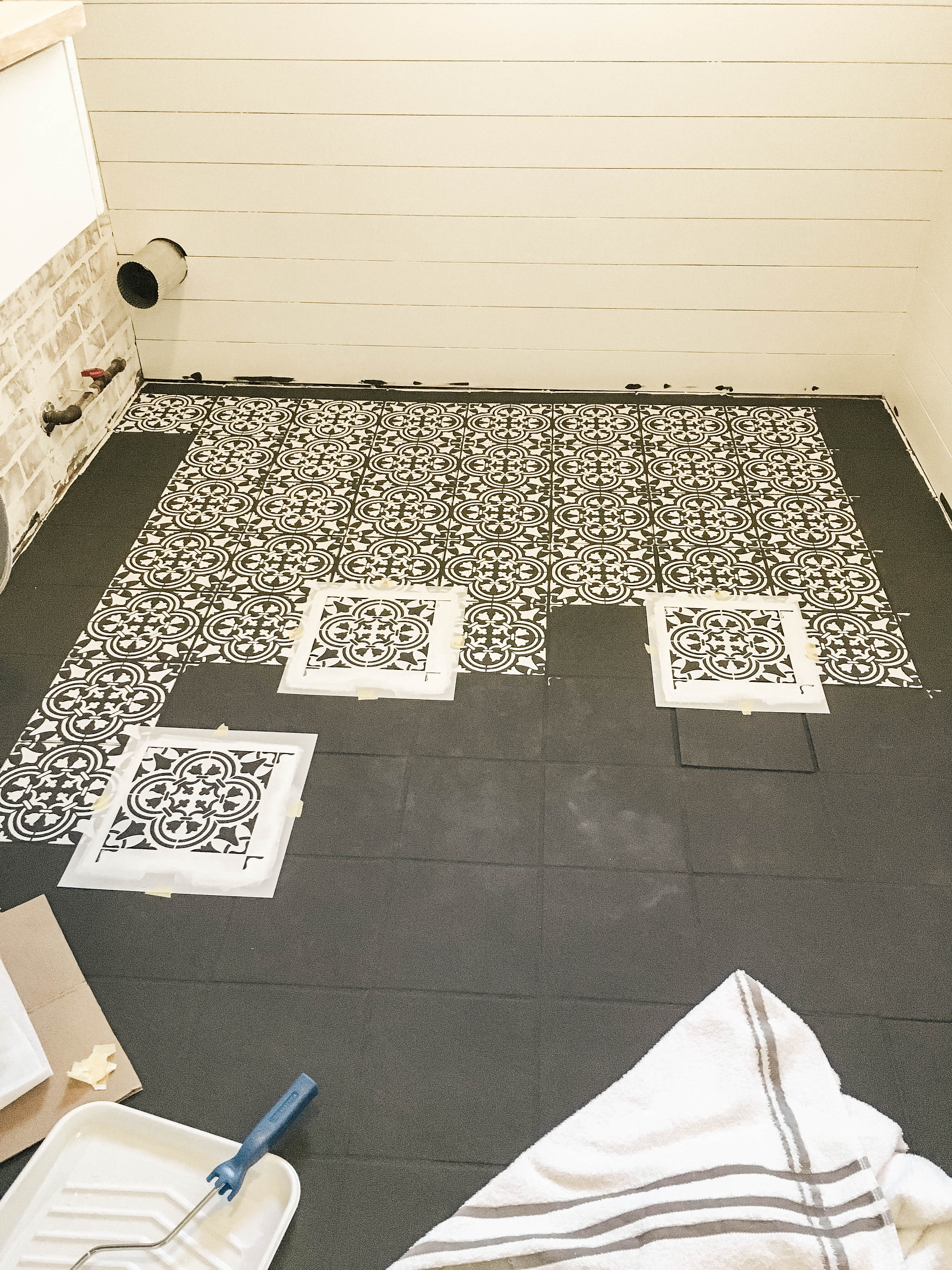 Have outdated floors that need a quick makeover? I'm sharing a step by step tutorial for how I did just this with stencil painted tile floors.