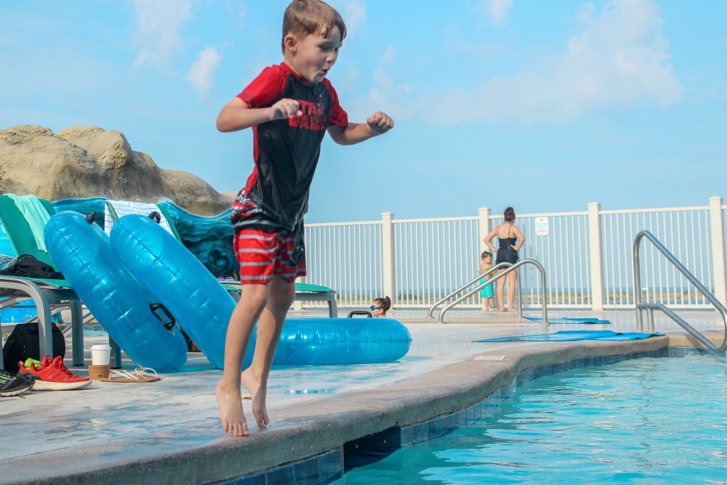 kid jumping in water at Margaritaville resort