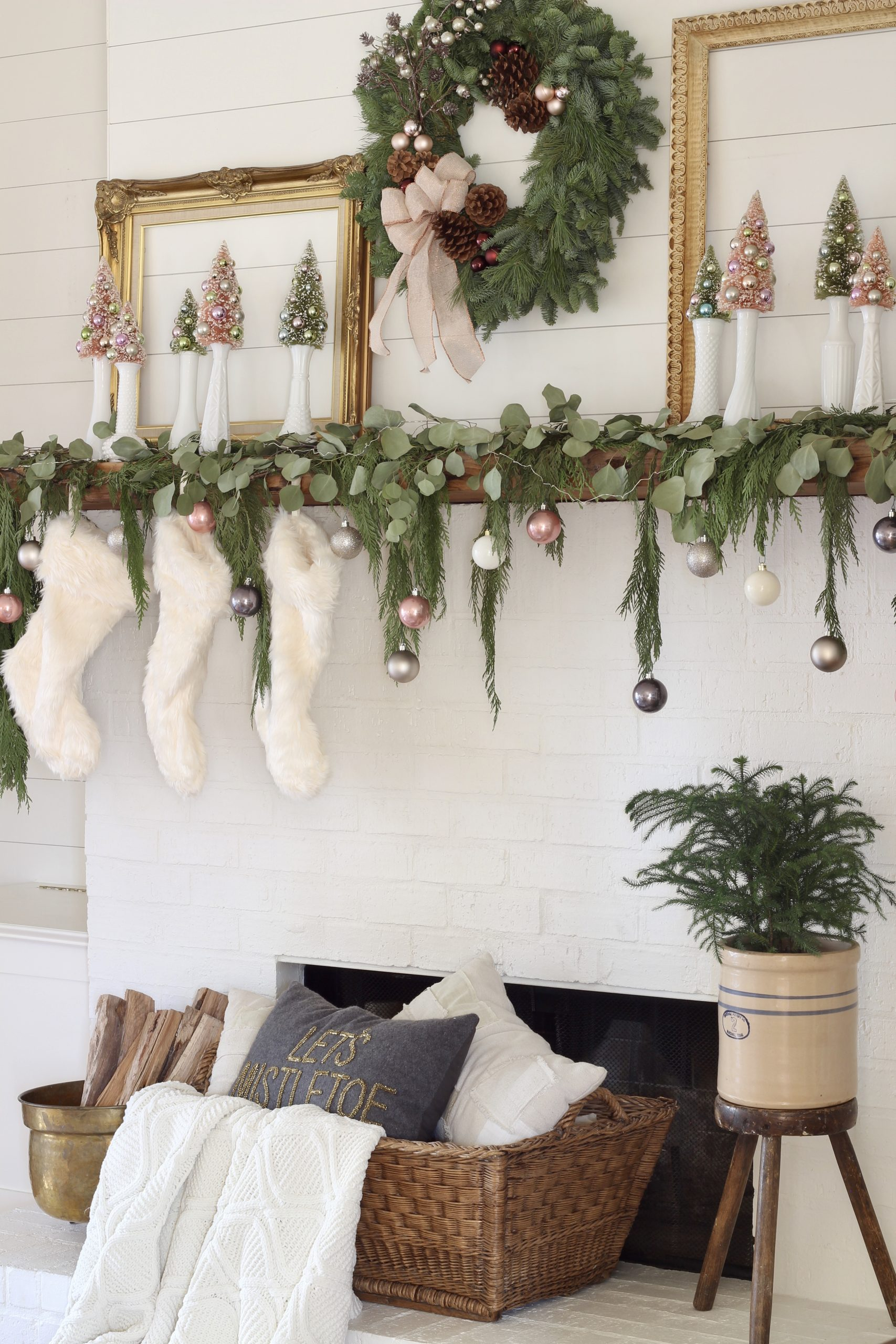 Evergreen wreath about Christmas mantel