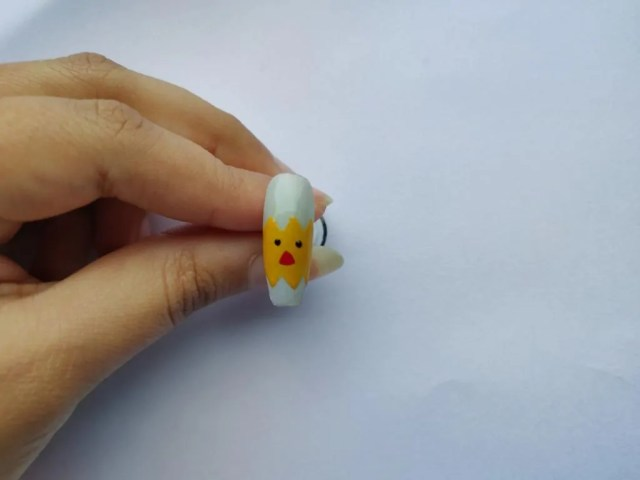 Chicken nail art design in yellow