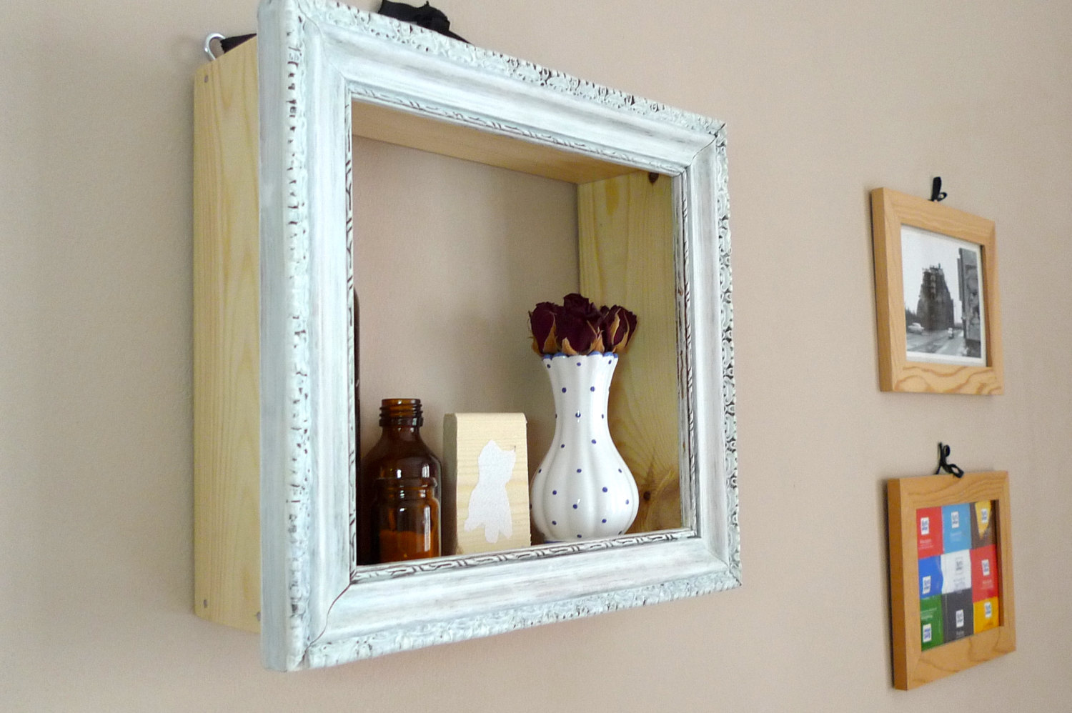 cheap way to decorate living room modern lights for diy: shelves of old picture frames - beautyharmonylife
