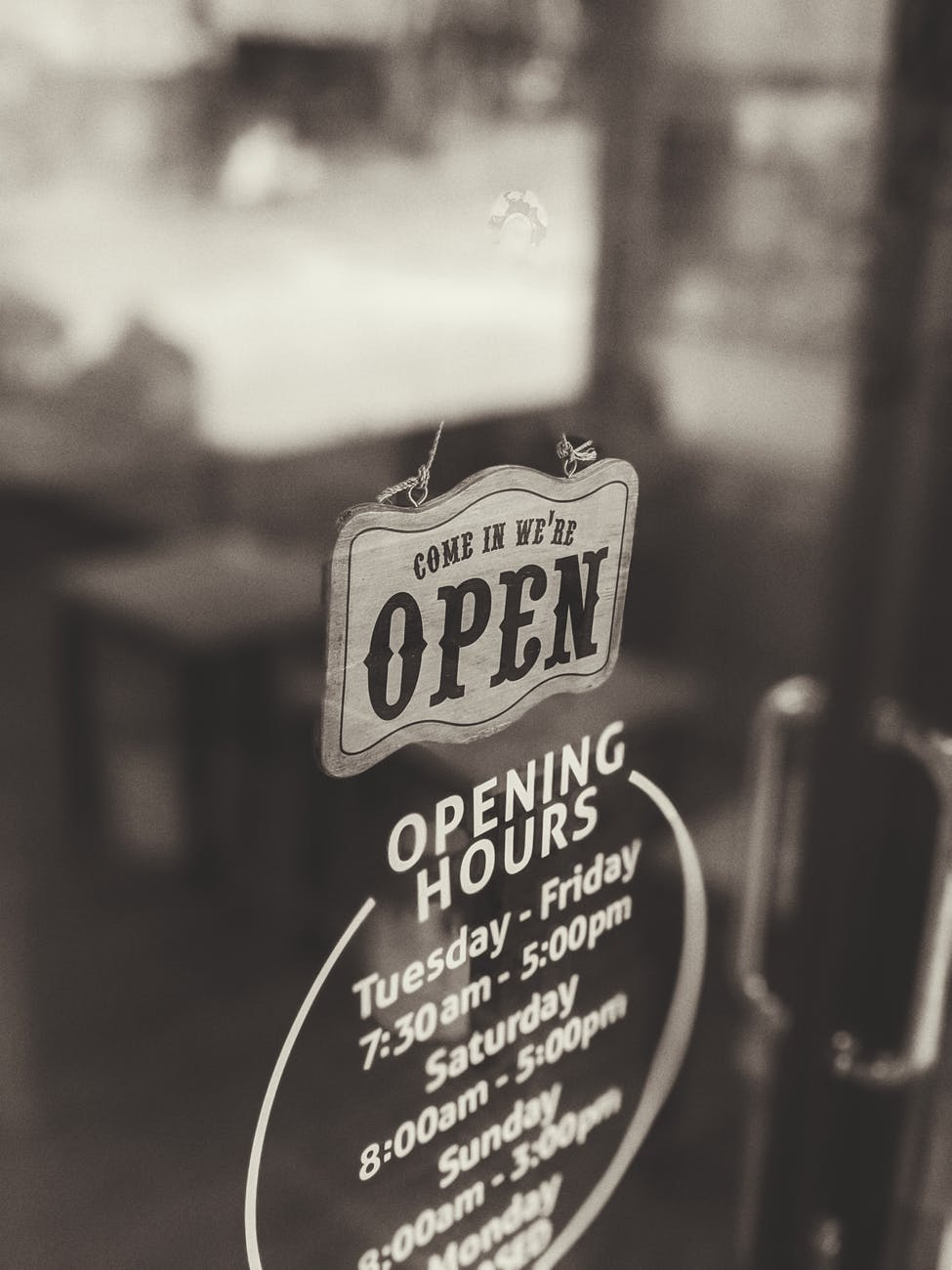 an open sign hanging on the door of a business establishment