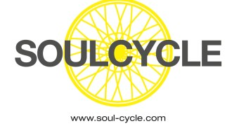 SoulCycle logo with a yellow bike wheel and gray text that says SOULCYCLE