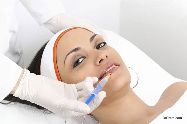 Young woman having lip augmentation at beauty clinic