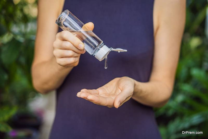 woman using natural Hand Sanitizer