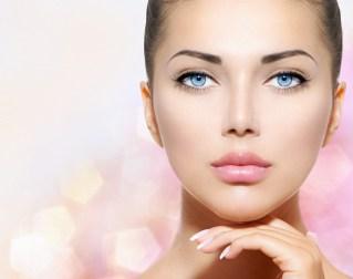 Beauty Portrait. Beautiful Spa Woman Touching her Face. Perfect